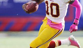 Washington Redskins quarterback Robert Griffin III (10) scrambles during third quarter action at MetLife Stadium, East Rutherford, N.J., Oct. 21, 2012. (Preston Keres/Special to The Washington Times)