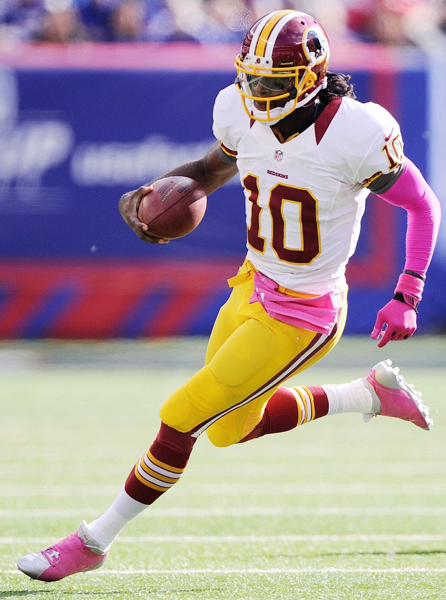 Washington Redskins quarterback Robert Griffin III (10) scrambles during third quarter action at MetLife Stadium, East Rutherford, N.J., Oct. 21, 2012. (Preston Keres/Special to The Washington Times)