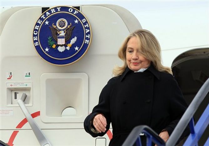U.S. Secretary of State Hillary Rodham Clinton arrives at Zagreb international airport, Croatia, Wednesday, Oct. 31, 2012. Clinton is currently touring northern Africa and southeast Europe. (AP Photo/Damir Sencar, Pool)