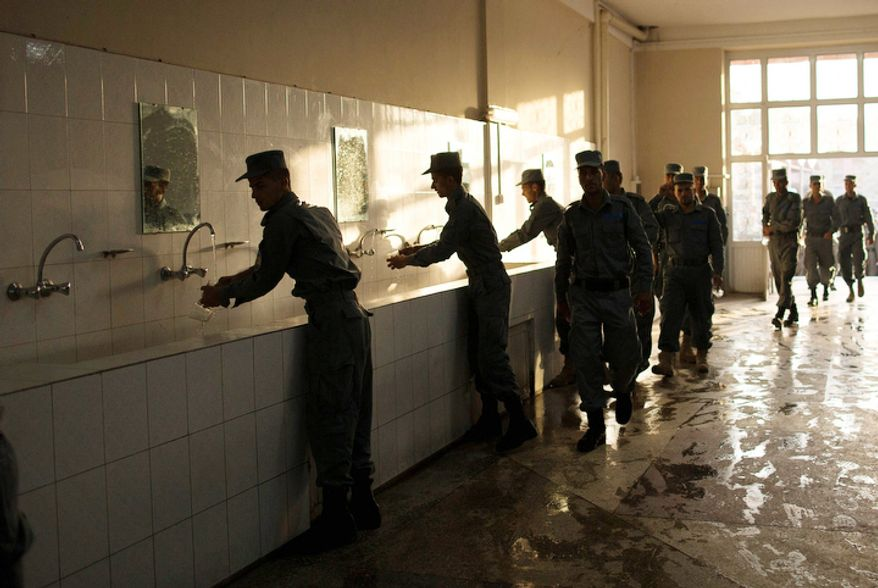 Afghan police officers line up to wash their hands before breakfast at the police academy in Kabul, Afghanistan. (AP Photo/Anja Niedringhaus)
