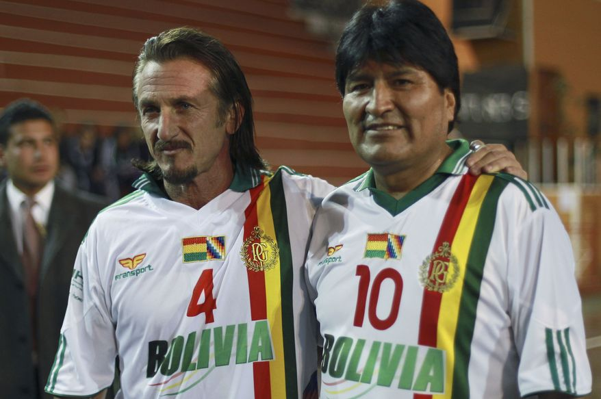 Bolivian President Evo Morales (right) and actor Sean Penn pose for photographs before participating in a friendly soccer match in La Paz, Bolivia, on Tuesday, Oct. 30, 2012. (AP Photo/Juan Karita)