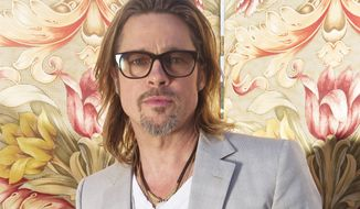 Actor Brad Pitt poses for photographs during the 65th Cannes Film Festival in Cannes, France, on Wednesday, May 23, 2012. (AP Photo/Joel Ryan)