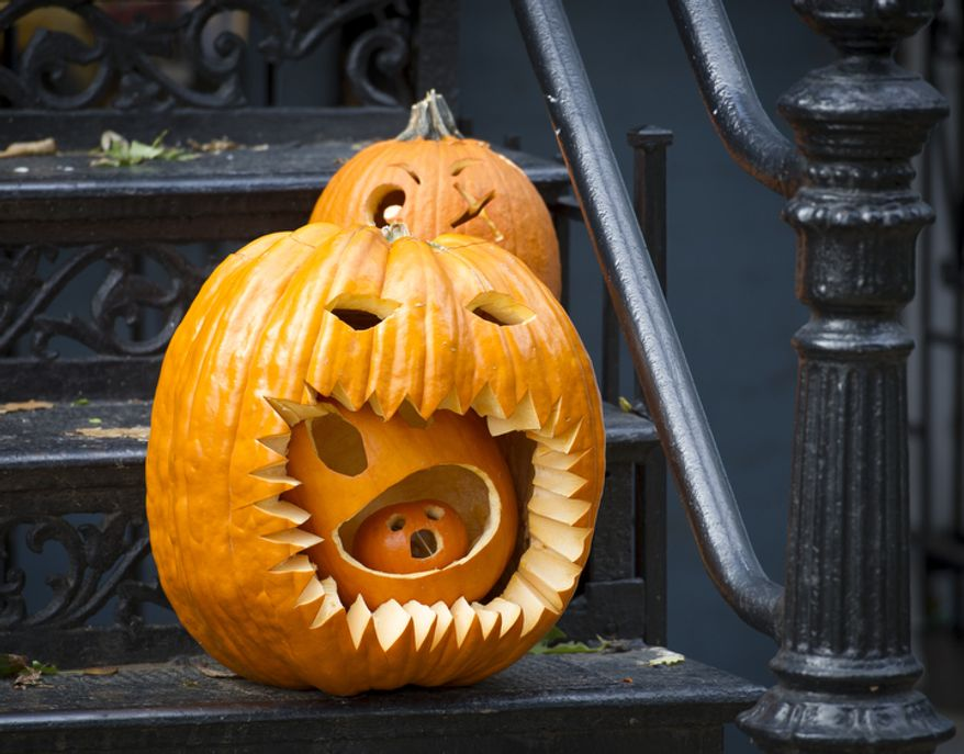 Decorated pumpkins sit on the steps of a home on North Carolina Avenue SE in Washington, D.C., Wednesday, Oct. 31, 2012. (Rod Lamkey Jr./The Washington Times)