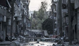 Destroyed buildings line a desolated street in the Bustan Al-Pasha district of Aleppo, Syria, on Tuesday, Oct. 30, 2012, after several weeks of intense battles between rebel fighters and the Syrian army. (AP Photo/Narciso Contreras)
