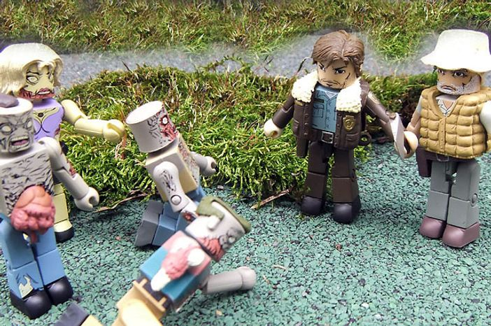 Rick and Dale from Diamond Select Toys' The Walking Dead Minimates fight off a group of miniature zombies. (Photograph by Joseph Szadkowski / The Washington Times)