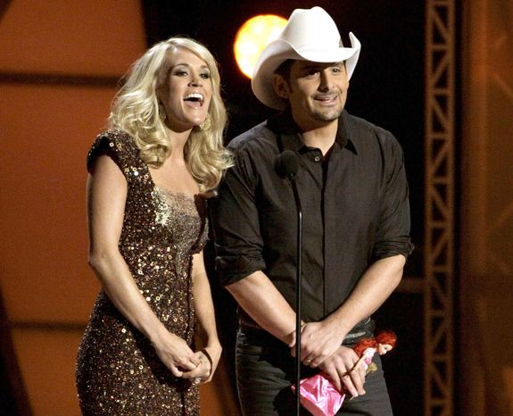 ** FILE ** Carrie Underwood and Brad Paisley co-host the 45th annual CMA Awards in Nashville, Tenn., on Wednesday, Nov. 9, 2011. (AP Photo/Mark Humphrey)
