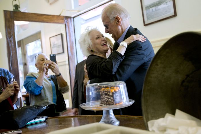 Vice President Joseph R. Biden embraces a patron at the Station 400 restaurant during a campaign stop on Wednesday, Oct. 31, 2012, in Sarasota, Fla. (AP Photo/Matt Rourke)