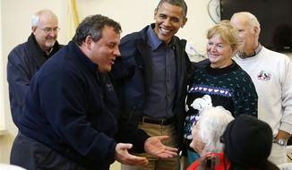 President Obama, center, and Federal Emergency Management administrator Craig Fugate, left, watch as New Jersey Gov. Chris Christie, second from left, meets with local residents at Brigantine Beach Community Center, Wednesday, Oct. 31, 2012, in Brigantine, NJ. Obama traveled to see first-hand the relief efforts after superstorm Sandy damaged the Atlantic Coast. (AP Photo/Pablo Martinez Monsivais)