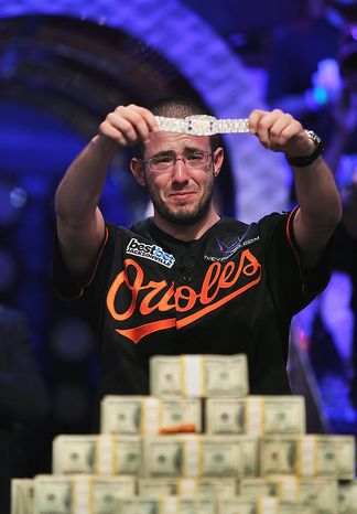 Greg Merson holds up his new bracelet after winning the World Series of Poker No-Limit Hold'em Main Event, Wednesday, Oct. 31, 2012, in Las Vegas. (AP Photo/Las Vegas Review-Journal, Jason Bean)