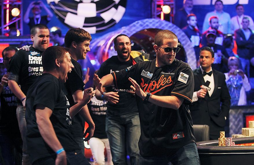 Greg Merson tries to hold back his friends after winning the World Series of Poker No-Limit Hold'em Main Event at Rio's Penn & Teller Theater in Las Vegas, Wednesday, Oct. 31, 2012. (AP Photo/Las Vegas Review-Journal, Jason Bean)