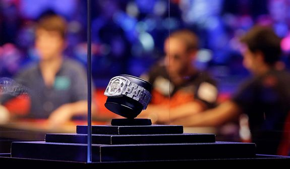 The championship bracelet is displayed during the World Series of Poker Final Table event, Wednesday, Oct. 31, 2012, in Las Vegas. (AP Photo/Julie Jacobson)