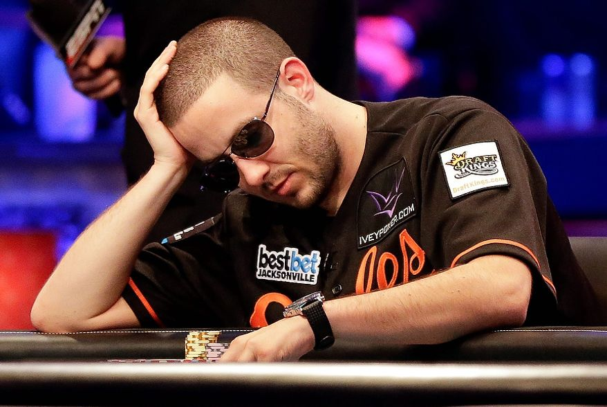 Greg Merson prepares to make his next move during the World Series of Poker Final Table event, early Wednesday, Oct. 31, 2012, in Las Vegas. (AP Photo/Julie Jacobson)