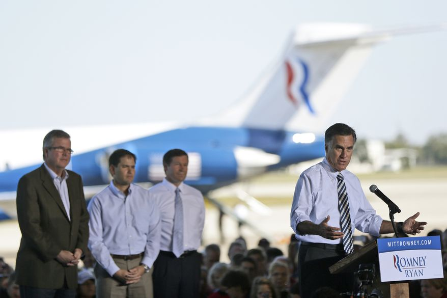Republican presidential candidate Mitt Romney (right) campaigns in Tampa, Fla., on Wednesday, Oct. 31, 2012. With him are (from left) former Florida Gov. Jeb Bush, Sen. Marco Rubio and Rep. Connie Mack. (AP Photo/Charles Dharapak)