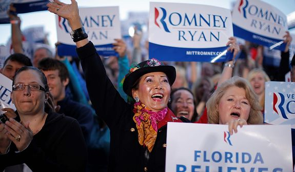 Somchintana Hart of Tampa, Fla., center, and others, cheer as Republican presidential candidate, former Massachusetts Gov. Mitt Romney campaigns in Tampa, Fla., Wednesday, Oct. 31, 2012. (AP Photo/Charles Dharapak)