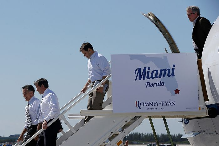Republican presidential candidate, former Massachusetts Gov. Mitt Romney, followed by, from second from left, Florida Senate candidate, Rep. Connie Mack, R-Fla., Sen. Marco Rubio, R-Fla., and former Florida Gov. Jeb Bush arrive in Miami for a Romney campaign event, Wednesday, Oct. 31, 2012. (AP Photo/Charles Dharapak)
