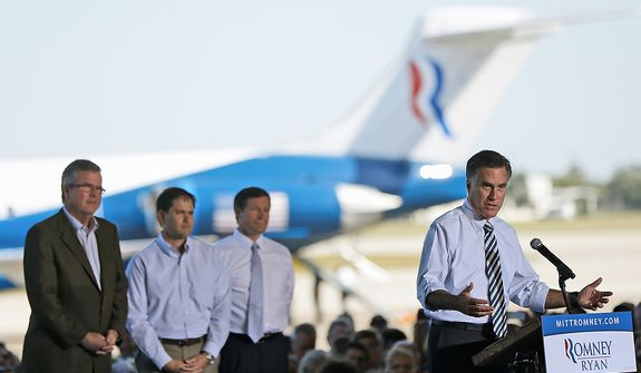 Republican presidential candidate, former Massachusetts Gov. Mitt Romney campaigns in Tampa, Fla., Wednesday, Oct. 31, 2012. Behind him, from left are, former Florida Gov. Jeb Bush, Sen. Marco Rubio, R-Fla., and Florida Republican Senate candidate, Rep. Connie Mack, R-Fla. (AP Photo/Charles Dharapak)