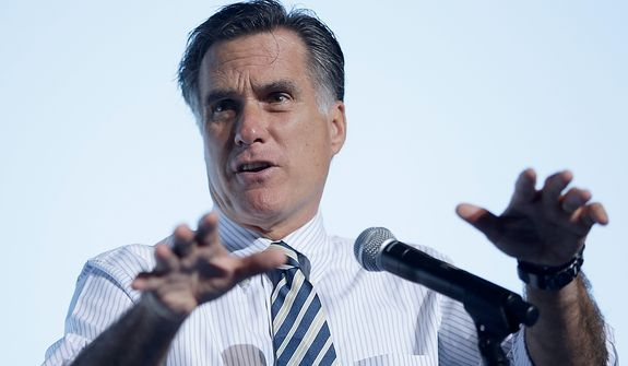 Republican presidential candidate, former Massachusetts Gov. Mitt Romney gestures while speaking at a campaign stop in Tampa, Fla., Wednesday, Oct. 31, 2012. (AP Photo/Charles Dharapak)