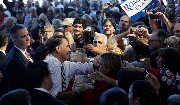 Republican presidential candidate, former Massachusetts Gov. Mitt Romney greets supporters during a campaign stop in Tampa, Fla., Wednesday, Oct. 31, 2012. (AP Photo/Charles Dharapak)