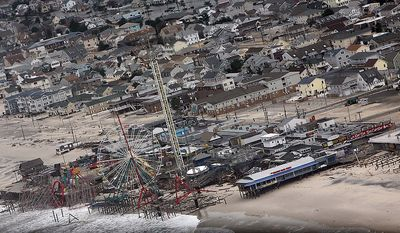 This photo made available by the New Jersey Governor's Office shows damage to the boardwalk in Seaside Heights, N.J. on Tuesday, Oct. 30, 2012 after superstorm Sandy made landfall in New Jersey Monday evening. (AP Photo/New Jersey Governor's Office, Tim Larsen)