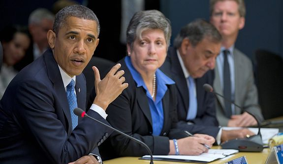 President Barack Obama, accompanied by members of his Cabinet, speaks at the Federal Emergency Management Agency (FEMA) Headquarters in Washington, Wednesday, Oct. 31, 2012, to discuss the recent superstorm Sandy. From left are, the president, Homeland Security Secretary Janet Napolitano, Defense Secretary Leon Panetta, and Housing and Urban Development (HUD) Secretary Shaun Donovan. (AP Photo/Carolyn Kaster)