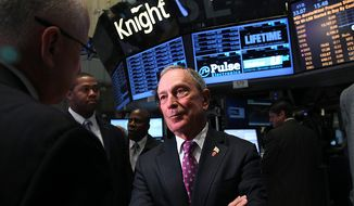 New York Mayor Michael Bloomberg talks to traders before ringing the opening bell at the New York Stock Exchange in New York on Wednesday, Oct. 31, 2012. (AP Photo/Seth Wenig)
