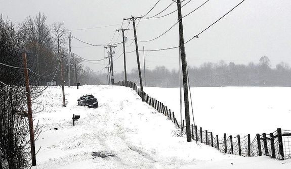 A truck makes it way through a snow-covered road in Beaver, W.Va., Wednesday, Oct. 31, 2012. Superstorm Sandy has already dumped up to 2 feet of snow in West Virginia, cutting electricity to about 271,00 customers and closing dozens of roads. (AP Photo/The Register-Herald, Rick Barbero)