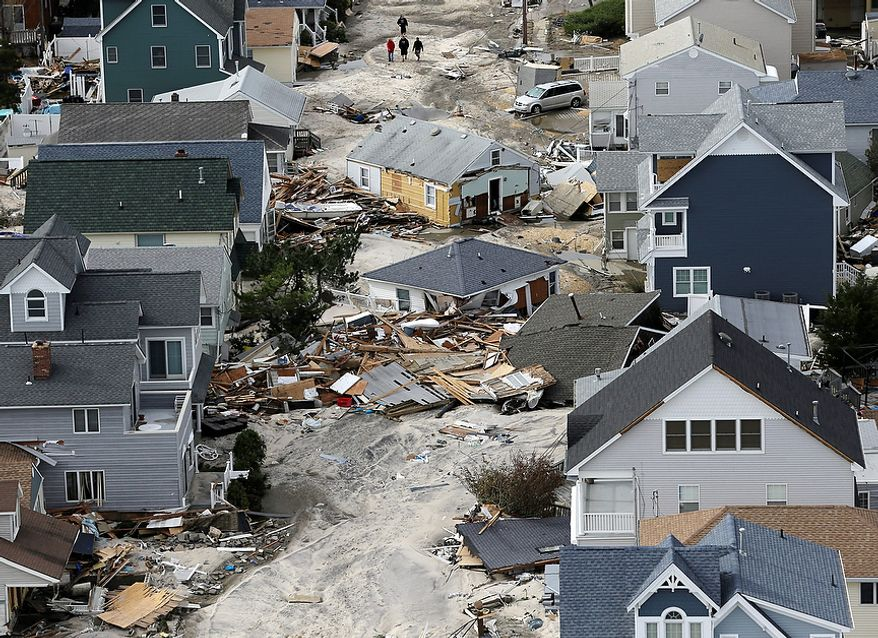 This aerial photo shows destruction left in the wake of superstorm Sandy, Wednesday, Oct. 31, 2012, in Seaside Heights, N.J. (AP Photo/Mike Groll)