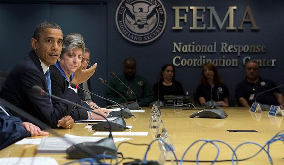 ** FILE ** President Barack Obama, accompanied by Homeland Security Secretary Janet Napolitano, second from left, and others, speaks about superstorm Sandy during a visit to the Federal Emergency Management Agency (FEMA) Headquarters in Washington, Wednesday, Oct. 31, 2012. (AP Photo/Carolyn Kaster)