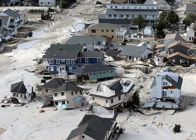 This aerial photo shows destroyed houses left in the wake of superstorm Sandy on Wednesday, Oct. 31, 2012, in Seaside Heights, N.J. (AP Photo/Mike Groll)