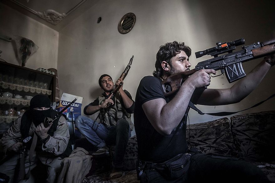 In this Monday, Oct. 29, 2012, photo, a rebel sniper aims at Syrian army positions in the Jedida district of Aleppo, Syria. Syrian fighter jets pounded rebel areas across the country on Monday with scores of airstrikes that anti-regime activists called the most widespread bombing in a single day since Syria's troubles started 19 months ago. (AP Photo/Narciso Contreras)
