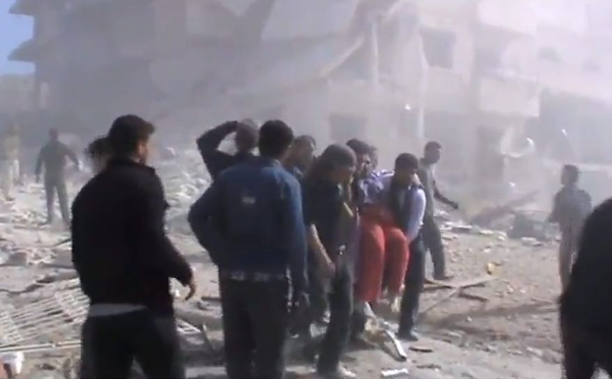 This image taken from video obtained from the Shaam News Network, which has been authenticated based on its contents and other AP reporting, shows attempts to rescue the wounded following heavy bombing from military warplanes in Idlib, in northern Syria, on Monday, Oct. 29, 2012. Syrian warplanes launched 60 airstrikes against rebel targets around the country on Monday, the most intense air raids across the country since the uprising began 19 months ago, according to anti-regime activists. At least 500 people were killed over the four-day period ending Monday when a U.N.-backed truce was supposed to be in effect, activists said, and the death toll for Monday so far has reached 80. (AP Photo/Shaam News Network via AP video)