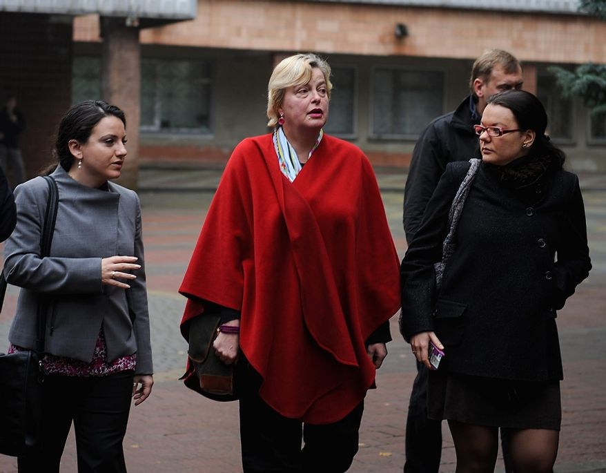 OSCE election observation mission special coordinator Walburga Habsburg Douglas (center) walks near the hospital where Yulia Tymoshenko, former Ukrainian prime minister and main opposition leader, undergoes medical treatment in Kharkiv, Ukraine, on Tuesday, Oct.30, 2012. Ukrainians authorities rejected her meeting wih Tymoshenko. (AP Photo/Dmitry Neymyrok)