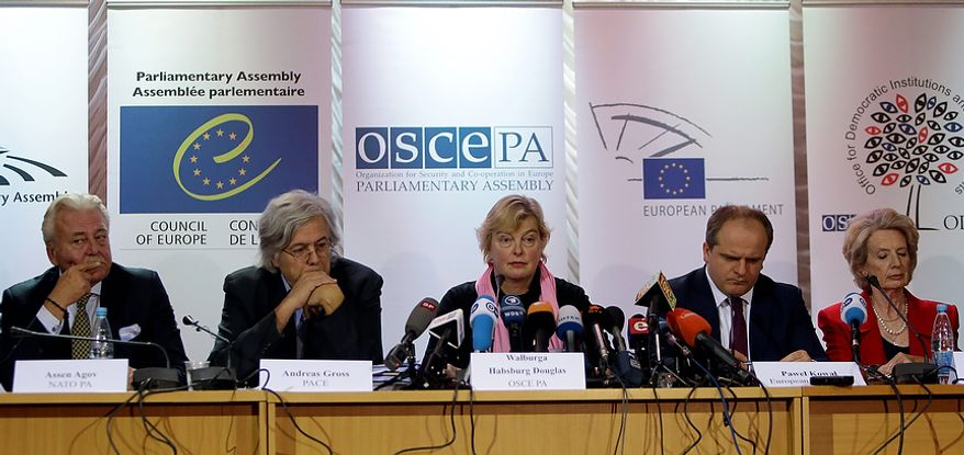 International election observers (left to right) Assen Agov, Andreas Gross, Walburga Habsburg Douglas, Pawel Kowal and Audrey Glover are pictured during a press conference in Kiev on Monday, Oct. 29, 2012. The OSCE election observers said Monday that democracy in Ukraine had suffered a setback in legislative polls marked by the absence of the jailed opposition leader Yulia Tymoshenko. (AP Photo/Efrem Lukatsky)