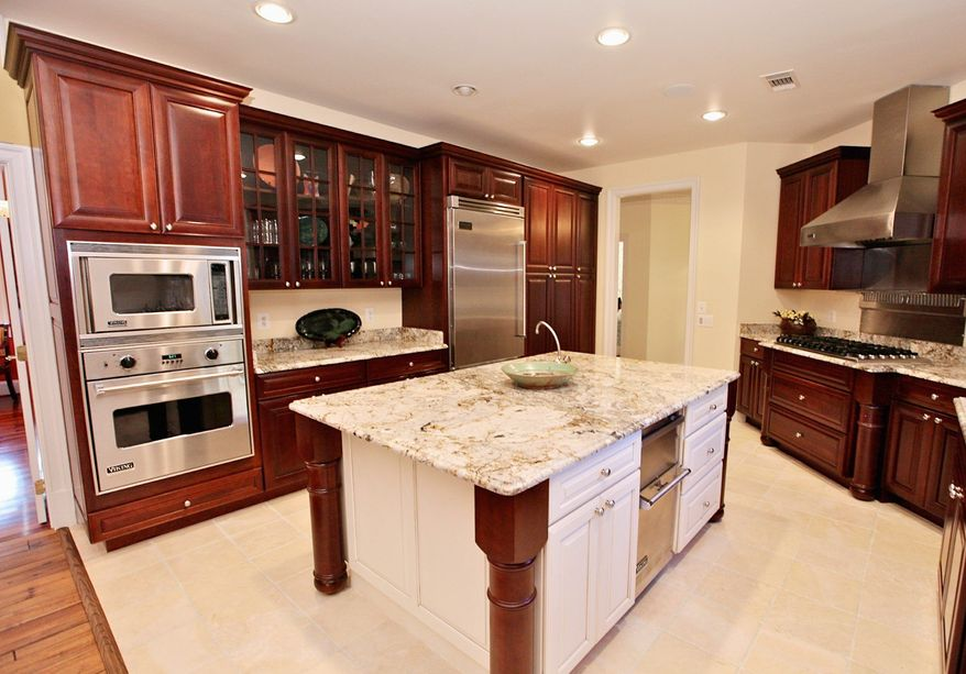 The kitchen has ceramic tile flooring, granite counters and stainless steel appliances.