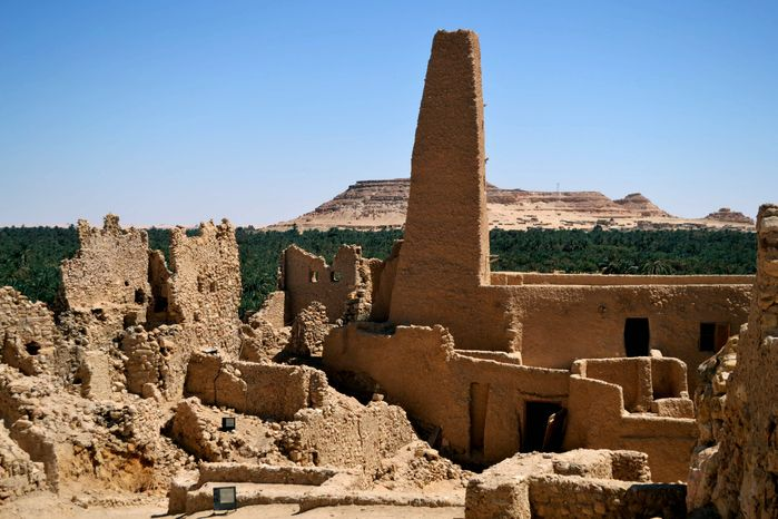 This September 2012 photo shows ruins called the Fortress of Shali in the Egyptian oasis of Siwa, a Berber town of some 27,000 people roughly 450 miles (about 725 kilometers) southwest of Cairo. The palm tree-lined area is known for its quiet charm, ancient ruins, abundant natural springs, a vast salt lake and rolling sand dunes in the surrounding desert. (AP Photo/Kim Gamel)