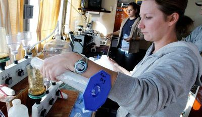 Zofia Noe, a Maryland Department of Natural Resources biologist, prepares water samples from a research vessel on the Patuxent River on Thursday. The monthly sampling cruise of the river is providing data on the impact of Hurricane Sandy. (Associated Press)