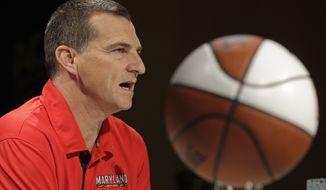 Maryland head coach Mark Turgeon speaks during the Atlantic Coast Conference NCAA college basketball media day in Charlotte, N.C., Wednesday, Oct. 17, 2012. (AP Photo/Chuck Burton)