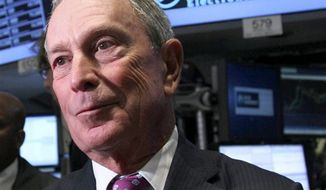 ** FILE ** In this Oct. 31, 2012 photo, New York City Mayor Michael Bloomberg talks to traders at the New York Stock Exchange in New York. Bloomberg backed President Obama over Republican Mitt Romney on Thursday, saying the president will bring leadership critically needed to fight climate change in the wake of Hurricane Sandy. (Associated Press)