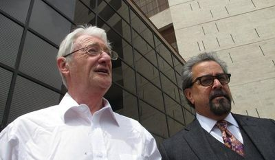 ** FILE ** Christopher Tappin (left), a Briton, leaves federal court with one of his lawyers, Kent Schaffer, in El Paso, Texas, on Wednesday, April 25, 2012. (AP Photo/Juan Carlos Llorca)