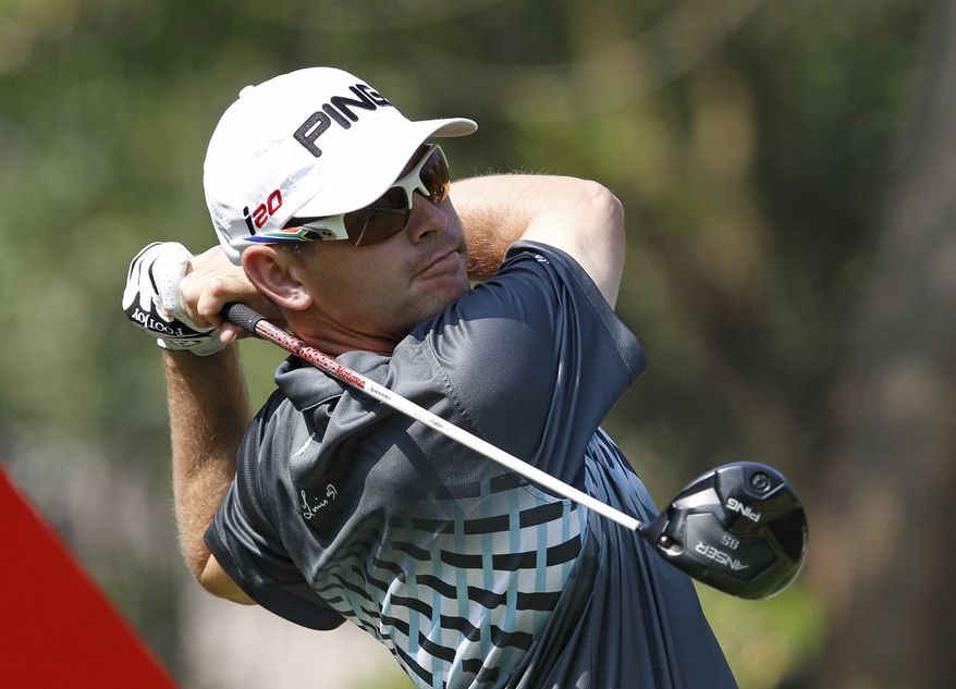 Louis Oosthuizen from South Africa tees off at the 12th hole during the first round of the WGC-HSBC Champions golf tournament in Dongguan, southern China's Guangdong province, Thursday Nov. 1, 2012. (AP Photo/Kin Cheung)