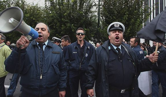 Police officers chant anti-government slogans during a protest in central Athens on Thursday, Nov. 1, 2012. More than a thousand protesting officers from the police, coast guard and fire department joined a rally in Athens to demonstrate against government cuts, in the latest protest ahead of a planned two-day general strike next week.   (AP Photo/Thanassis Stavrakis)