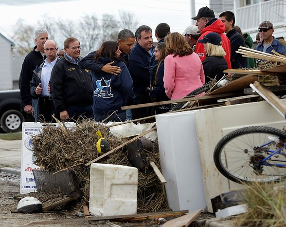 President Obama (center) and New Jersey Gov. Chris Christie meet with residents as they tour neighborhoods affected by superstorm Sandy, on Wednesday, Oct. 31, 2012, in Brigantine, N.J. Also with them is Sen. Bob Menendez (left). (AP Photo/Pablo Martinez Monsivais)