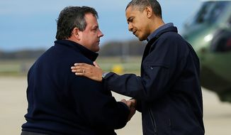 President Obama (right) is greeted by New Jersey Gov. Chris Christie upon the president's arrival at Atlantic City International Airport on Wednesday, Oct. 31, 2012, near Atlantic City, N.J. Mr. Obama traveled to the region to take an aerial tour of the New Jersey coastline damaged by Superstorm Sandy. (AP Photo/Pablo Martinez Monsivais)