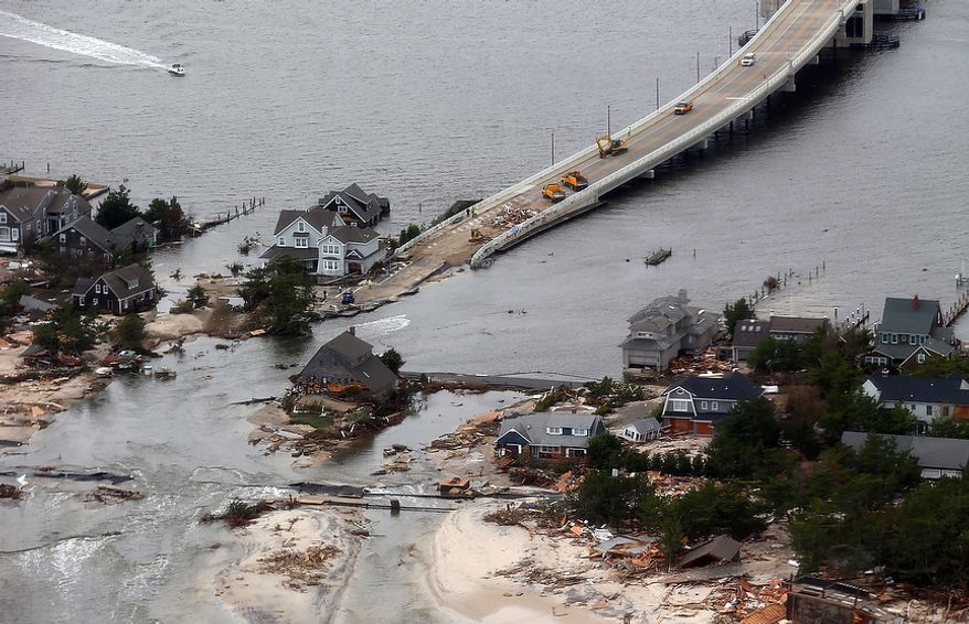 Storm damage along the Atlantic coast in Mantoloking, N.J., is pictured on Wednesday, Oct. 31, 2012, from a helicopter traveling behind the Marine One copter carrying President Obama and New Jersey Gov. Chris Christie on an inspection tour. (AP Photo/Doug Mills, Pool)