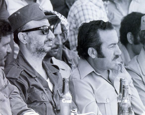 ** FILE ** Palestinian leader Yasser Arafat (left) and his deputy, Abu Jihad, whose nom de guerre was Abu Jihad, are shown in an undated image. (AP Photo/Palestinian Authority)