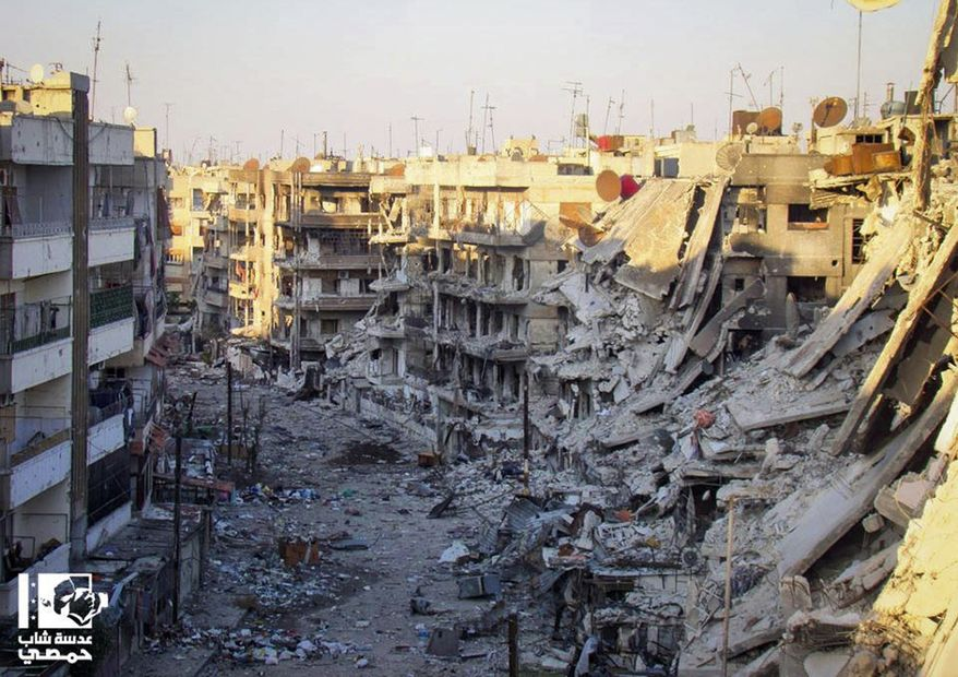 A citizen journalist's image taken on Wednesday, Oct. 31, 2012, and authenticated based on its contents and other AP reporting, shows buildings destroyed by the shelling of Syrian forces loyal to President Bashar Assad in the al-Qossour neighborhood in Homs province in central Syria. (AP Photo/Lens Yong Homsi)