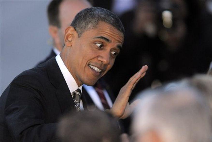 President Obama high-fives a supporter as he arrives at Denver International Airport Thursday, Nov. 1, 2012, in Denver. (AP Photo/Jack Dempsey)