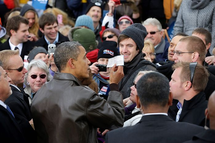 President Obama is handed a personal check made out to the American Red Cross from an unknown supporter during a campaign event at Austin Straubel International Airport in Green Bay, Wis., on Thursday, Nov. 1, 2012. Mr. Obama resumed his presidential campaign with travel to the key battleground states of Wisconsin, Colorado, Nevada and Ohio today. (AP Photo/Pablo Martinez Monsivais)