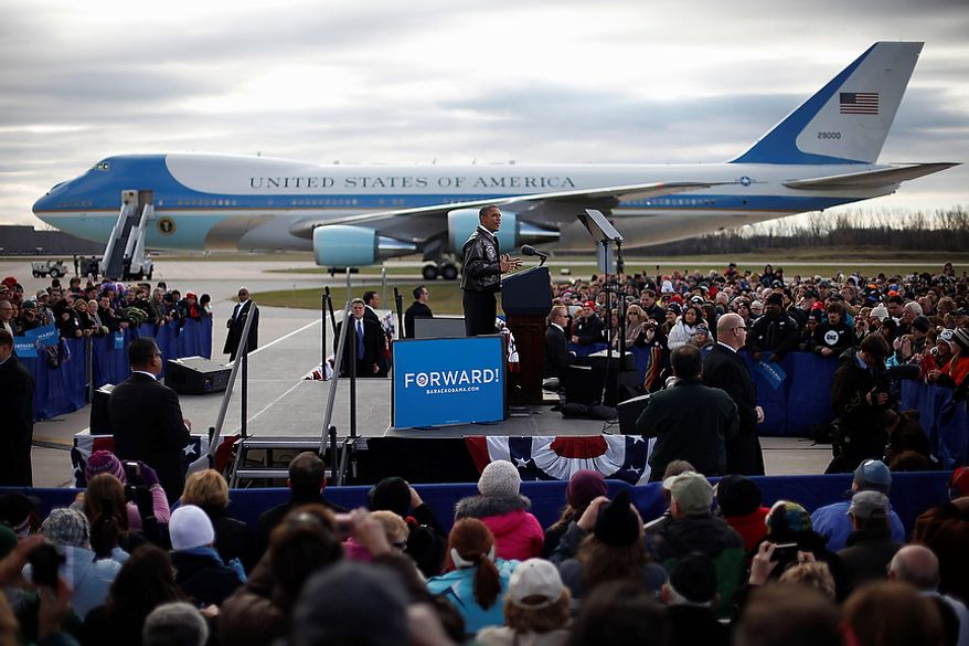 With Air Force One in the background, President Obama speaks to supporters during a campaign event on the apron at Austin Straubel International Airport in Green Bay, Wis., on Thursday, Nov. 1, 2012. Mr. Obama resumed his presidential campaign with travel to the key battleground states of Wisconsin, Colorado, Nevada and Ohio today. (AP Photo/Pablo Martinez Monsivais)