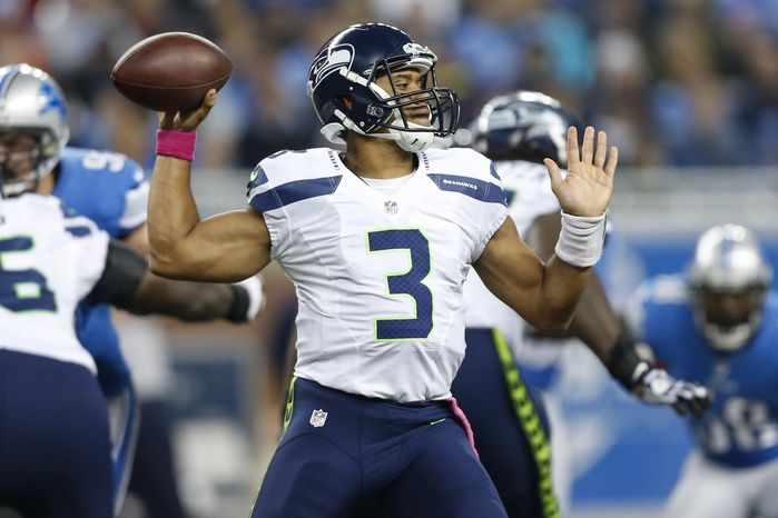 Seattle Seahawks quarterback Russell Wilson (3) passes the ball during an NFL football game against the Detroit Lions, Sunday, Oct. 28, 2012. in Detroit. (AP Photo/Rick Osentoski)